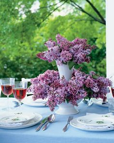The secret to this multitiered flower arrangement is amazingly easy: Just set a vase inside a serving bowl and fill the bowl with floral foam. Lilacs make a beautiful centerpiece for a baby shower, but you could also use wisteria, lily of the valley, cherry blossoms, or any other cascading flower.