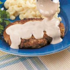 Chicken Fried Steak 2  1/2 pound beef top sirloin steak (1/2 inch thick)  1/4 cup all-purpose flour  1/4 cup seasoned bread crumbs  1 egg  2 teaspoons water  3 tablespoons canola oil  COUNTRY GRAVY:  2 tablespoons all-purpose flour  1-1/4 cups 2% milk  1/4 teaspoon salt  1/4 teaspoon white pepper