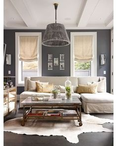 Grey walls, white trim, light khaki furniture/curtains