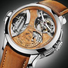 Greubel Forsey ilkini 2014 yılında tanıttığı Art Piece koleksiyonunu genişletiyor. 'Greubel Forsey Art Piece 2 Edition 1 Watch' saat 12 ila 2 konumu arasındaki 30 derece eğimli çift akslı tourbillonu ile dikkat çekiyor. Aynı tourbillon kurma tepesine de lenslerle görülebilecek şekilde işlenmiş. Kauçuk kadranda saat 6 konumunda damga motifi yer alıyor. Bu damganın etrafında Greubel Forsey markasının DNA özellikleri Keşif (Invention) Mimari (Architecture) ve Üretim (Manufacture) kelimeleri…