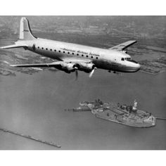 USA New York State New York City New York Harbor American Airlines plane over Statue of Liberty Canvas Art - (24 x 36)