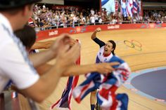 Dani King of Great Britain celebrates winning the gold medal and breaking the world record in the women's team pursuit track cycling finals on Aug. 4 at the Olympic Velodrome.