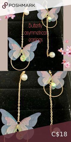 Butterfly earrings Stunning asymmetrical butterfly dangle earrings. Light as a feather Jewelry Earrings Feather Jewelry, Butterfly Earrings, Dangle Earrings, Dangles, Women Jewelry, Purple, Closet, Things To Sell, Armoire