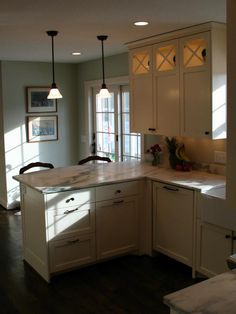 This gives you an idea of how that will look without upper cabinets with a french door in the kitchenette. I'd extend the last cabinet down to the counter for an appliance garage, if you go that route. But I've always loved open shelves on top.