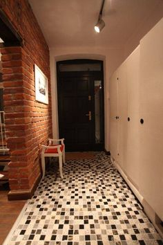 ksawery brick house: styl Nowoczesny, w kategorii Korytarz, przedpokój i schody zaprojektowany przez REFORM Konrad Grodziński