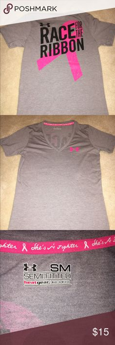 """Sz. S RACE FOR THE RIBBON Breast Cancer UA Shirt This is a semi-fitted t-shirt made of soft cotton in like new condition. I wore it to support a family member during a walk and felt proud of the message displayed on the inside neck, """"she's a fighter."""" I have amassed a collection of these tees and so offer this gem to you. Bundle with the other UA tee and save! Under Armour Tops Tees - Short Sleeve"""
