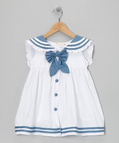 This frock's nautical style is fresh and fun-loving, whether worn near the waves or on a walk through the park. Ruffles around the collar and a big bow in front are all the accessories that a little sailorette needs. Size note: Only infant sizes include diaper cover. Includes dress and diaper cover
