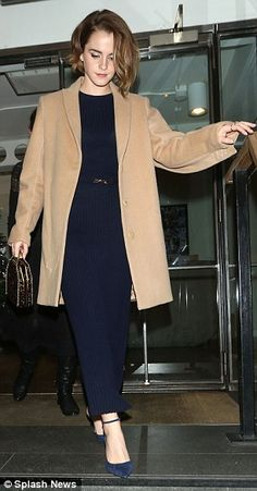 She means business: Emma opted for a sharp ensemble and her choice of colour code was a st...