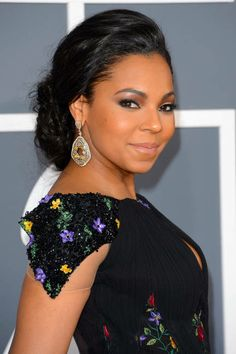 Ashanti's soft braided bun is well-suited for black-tie affair: add clip-in extensions to whole head, except for perimeter; for bun w/ added dimension, split low ponytail into 4 sections & alternate b/n braids & fishtails before coiling them around into large knot