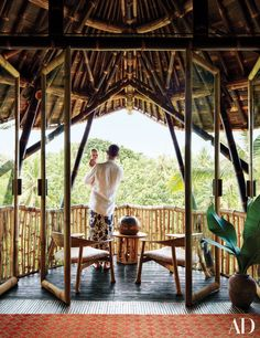 Steven and Ramona Puente look over a teak forest from the master bedroom's balcony; door frames fashioned from six-inch-diameter bamboo poles with black bamboo handles. Styled by Michael Reynolds Bamboo Roof, Bamboo Poles, Bamboo Architecture, Stairs Architecture, Bamboo Building, Bamboo Structure, Bamboo Construction, Bali Travel Guide, Open Air