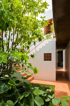 Ho Chi Minh apartment block features patterned terracotta facade and garden pockets