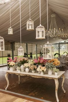 vintage wedding decor-Eclectic Pitchers and Container after container of lovely blooms plus chandeliers and birdcages