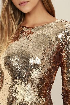 If you're ready to be the most striking girl in the room this year, then do it! Get yourself the Dress the Population Lola Gold Sequin Dress and flaunt it like there's no tomorrow! A showstopping array of shiny gold sequins make their way down a sexy bodycon silhouette with long sleeves. Bateau neckline dips into a V-back, while the thick design of this dazzling dress is a perfectly warm choice for the cooler seasons. Hidden back zipper.