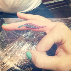 Colored finger tattoo. Feathers appear when angels are near