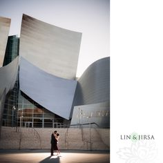 We like the beautiful backdrop and the action.  We would like pictures like this, but Cynthia doesn't want us to get lost in the backdrop.   Downtown Los Angeles Engagement | Ronica & Dheeraj