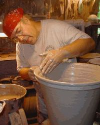 Guy Wolff Pottery - Mr Wolff makes amazing pots and his son is also an amazing potter!  Check out his studio!!