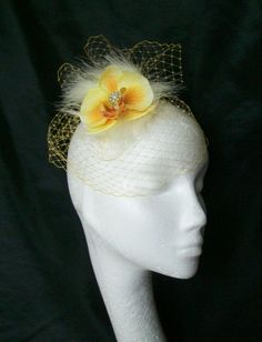 Order Now from www.indigodaisyweddings.co.uk Specialising in stunning bespoke cocktail fascinators and formal hats in a wide range of colours, perfect for Royal Ascot and The Kentucky Derby. Plus all your wedding floral accessories including shoe clips, bandeau veils,vintage flapper bands, feather and flower fascinators, feather fans, fairy wands, wrist corsages, wedding bouquets & buttonholes. Worldwide Delivery.
