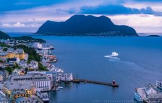 https://flic.kr/p/LuEKqu | The beautiful Ålesund in Norway | www.aziznasutiphotography.com                    Ålesund is a port town on the west coast of Norway, at the entrance to the Geirangerfjord. It's known for the art nouveau architectural style in which most of the town was rebuilt after a fire in 1904, as documented at the Jugendstilsenteret museum. There are panoramic views of Ålesund's architecture, the surrounding archipelago and fjords from the Mount Aksla lookout.