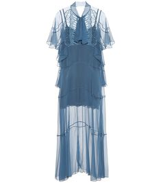 Chloé - Embroidered silk gown - Debuting at Paris Fashion Week, this airy silk-chiffon gown from Chloé exudes French elegance that has come to define the label. Crafted in France, this dusk-blue style features tiers of loose ruffles that create movement with every step. The dress's romantic appeal is enhanced by the scalloped embroidery at the bodice that frames the self-tie neckline and rounded buttons. Style yours with pumps for a dreamy evening ensemble. seen @ www.mytheresa.com