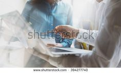 Team work process. Photo young business crew working with new startup project. Project managers meeting. Analyze plans, papers. Blurred background, film effect
