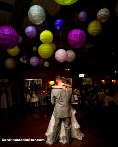 Hang something like this in purple, black, silver above the dance floor to define the space. Lanterns or maybe tissue paper poms?