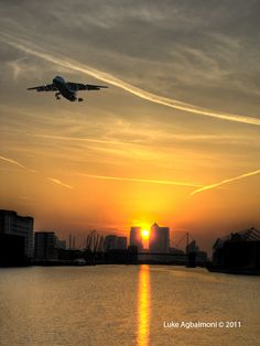 Plane taking off from London City Airport in the London Docklands - London's best kept secret and most convenient airport.