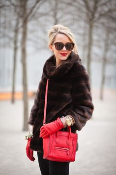 Loving everything about this look: Faux fur, stylish sunnies, pop of color and red lips to complete the look. Tres chic!