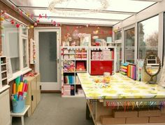 what an awesome craft room...look at all that light...i'm in serious love with this space.