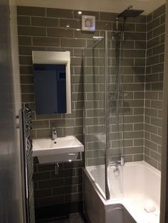 Sage metro tile small bathroom with l shaped shower bath