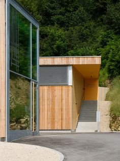 Image 9 of 18 from gallery of Operation Center Burgergemeinde / bauzeit architekten. Photograph by Yves André Wood Siding, Industrial, Swiss Architecture, Garage Doors, Gallery, Building, Outdoor Decor, Home Decor, Communities Unit