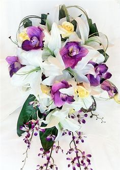 This would be perfect for the bridesmaids :) Natural Touch Off White Lilies & Purple Orchids Cascading Bouquet