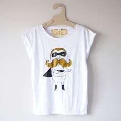 One for the facial hair lovers, this hand screen printed tshirt features my hand-drawn Moustache Hero illustration in shimmering gold ink