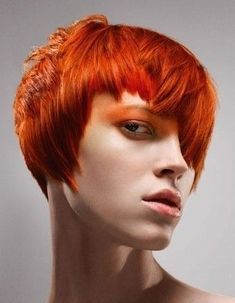 Hair was coloured a bright red all over then cut into short layered and straightened and fingered through for maximum definition Hairstyle by: Mark Hayes Hairstyle picture by: Colin Roy Salon: Vidal Sassoon Location: London Short Choppy Layered Hair, Short Red Hair, Short Hair Styles, Choppy Cut, Short Layers, Pixie Hairstyles, Vintage Hairstyles, Cool Hairstyles, Hairstyle Ideas