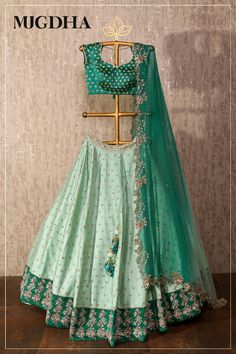 Mint green paired up with pista green floor length lehenga with matched up dupatta all over golden embroidered with small florals. They can customize the color and size as per your requirement