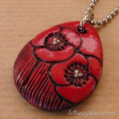 Red poppies are blooming on this romantic necklace handmade in polymer clay...(In Italian with English translation )