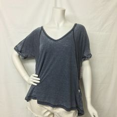 This twist on FP fave the Keep Me Tee, features the same slouchy, oversized fit, in a so-soft burnout jersey. Ribbed V-Neck with rolled short sleeves. Subtle Hi-Lo hem. **Please Note: Each tee has its own unique burnout pattern and will vary in color and sheerness! 50% Polyester 38% Cotton 12% Rayon Machine Wash Cold...  Read more »