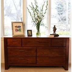 The Somette Mahogany-honey dresser is a functional embellishment with a dashing, modern design. This piece has a simple, sharp design that gives a very nonchalant, non-overpowering feel to the collective tone of your bedroom.