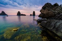 Sunrise over the Rocks.  Aci Trezza, Sicily - Photo by Adam Allegro, http://catchthejiffy.com