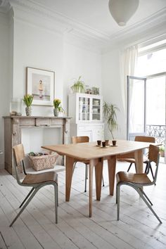 Love the wooden table and the lightness of the room! Originally from http://decor8blog.com/2012/05/22/lovely-home-of-cotton-milk-designer-justine-glanfield/