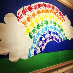 March bulletin board (child's hand print as rainbow)