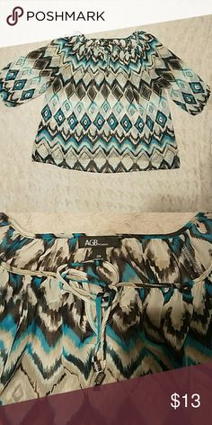 Ikat Print Blouse Blouse is in EUC. No damage or signs of wear. There is a tie at the scoop neck. Shirt is sheer. 3/4 length sleeves with elastic at the bottom of them. Color of print is blue black, and tan. AGB Tops Blouses