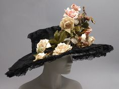 Woman's hat   Made in Paris, ca. 1910   Designed by Mme Georgette (Frenc, active ca. 1900-1925)   Materials: black lace and artificial flowers on wire frame   Philadelphia Museum of Art