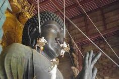 Giant Buddha (with cleaning people!)