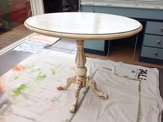 Oval table painted by Margaret Whitcher with old white and finished with dark and clear wax.