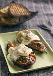 Baked aubergine stuffed with spinach, pine nuts, tomatoes and Pecorino cheese