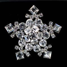 """Vintage Statement Snowflake Swarovski Rhinestone Crystal Brooch Pin is absolutely amazing!  This is an older pin that is made of a softer pot metal that has been reset with Swarovski rhinestones in entirety.  It is a stunning piece perfect for the holidays, a Christmas party, or simply accenting your winter wardrobe.  To  inspect photos, simply click on the binocular icon on the top right corner of any photo.   Excellent condition, the brooch pin measures 2 1/2"""" in diameter and weig..."""