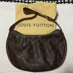Louis Vuitton Croissant MM Authentic Louis Vuitton Monogram Croissant MM. Excellent Condition. This is the medium size of the bag that is a simple croissant shape crafted of Louis Vuitton monogram on toile canvas. This is complimented with signature vachetta cowhide leather piping and a strap handle. There is brass hardware including a durable brass zipper that opens to a durable and stain resistant raspberry red microfiber interior with zipper and patch pockets. Comes with dustbag. Trade…