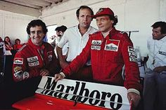 Estoril, October 1984: Niki Lauda pictured with McLaren team mate Alain Prost (left) and team boss Ron Dennis (centre). Lauda would take the world championship by just half a point from Prost. © Schlegelmilch