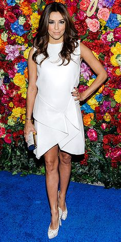 EVA LONGORIA Another fan of the LWD, the flawless Eva pairs her scalloped-hem mini with studded cream platforms and a white-and-gold clutch at a Ferragamo launch in N.Y.C.
