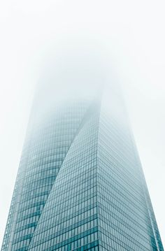 joel filipe photographs misty towers vanishing into the sky of madrid